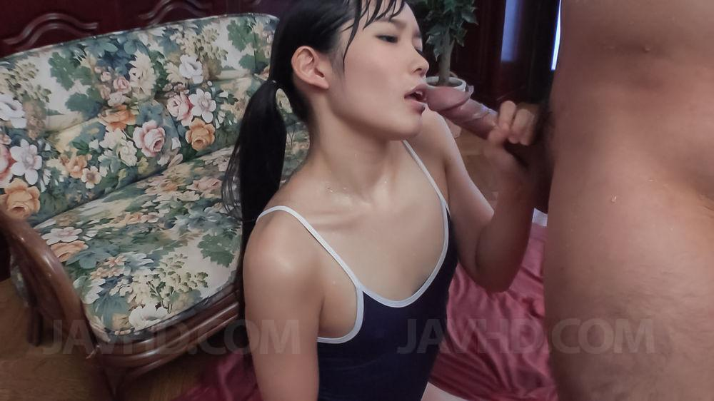 Yui Kasugano Asian in bath suit pours cum on palm after blowjob